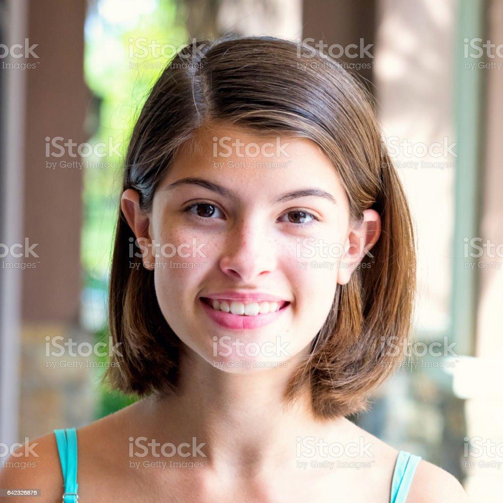 Smiling beautiful teenage girl stock photo