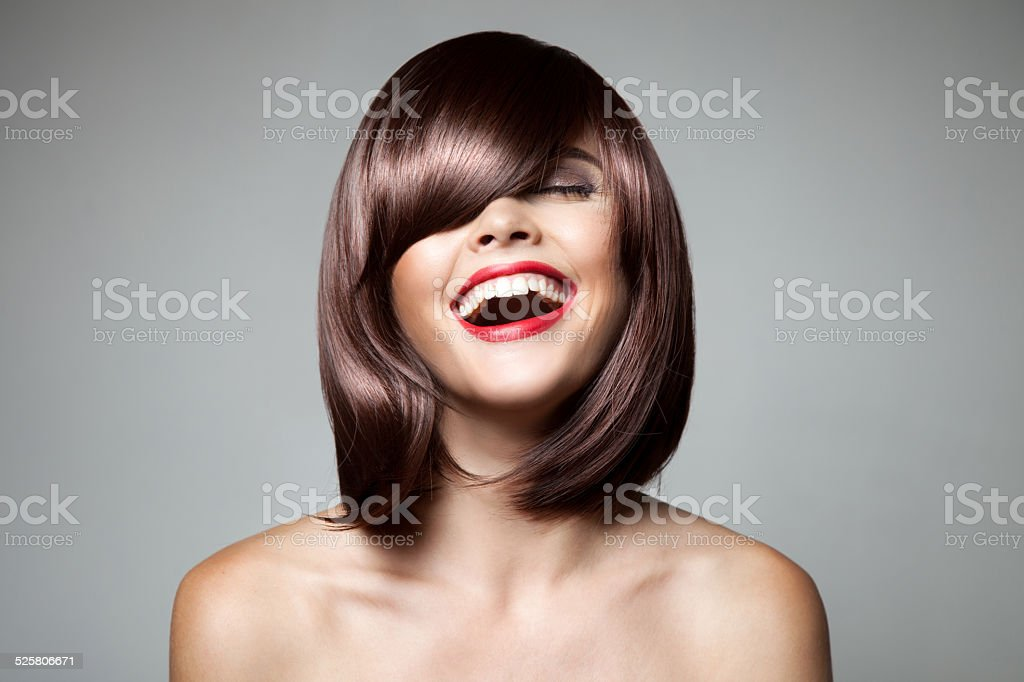 Smiling Beautiful Woman With Brown Short Hair. Haircut. stock photo