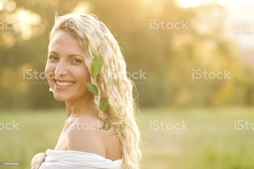 Smiling beauty at sunset royalty-free stock photo