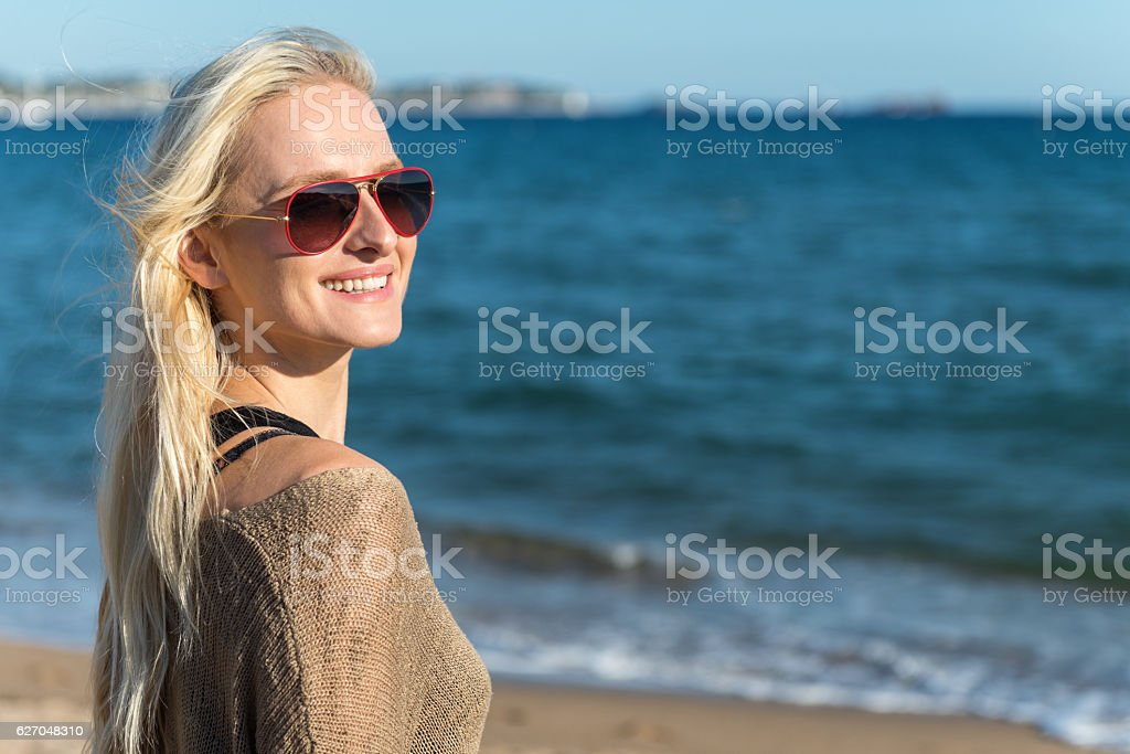 Smiling beauty portrait at beach stock photo