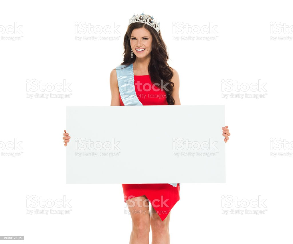 Smiling beauty queen holding placard stock photo
