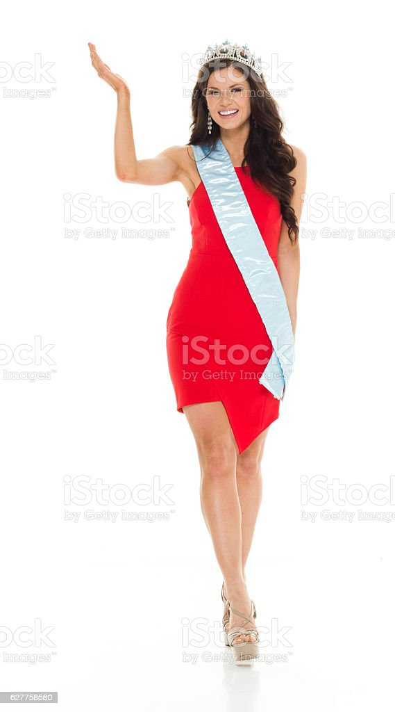 Smiling beauty queen presenting stock photo