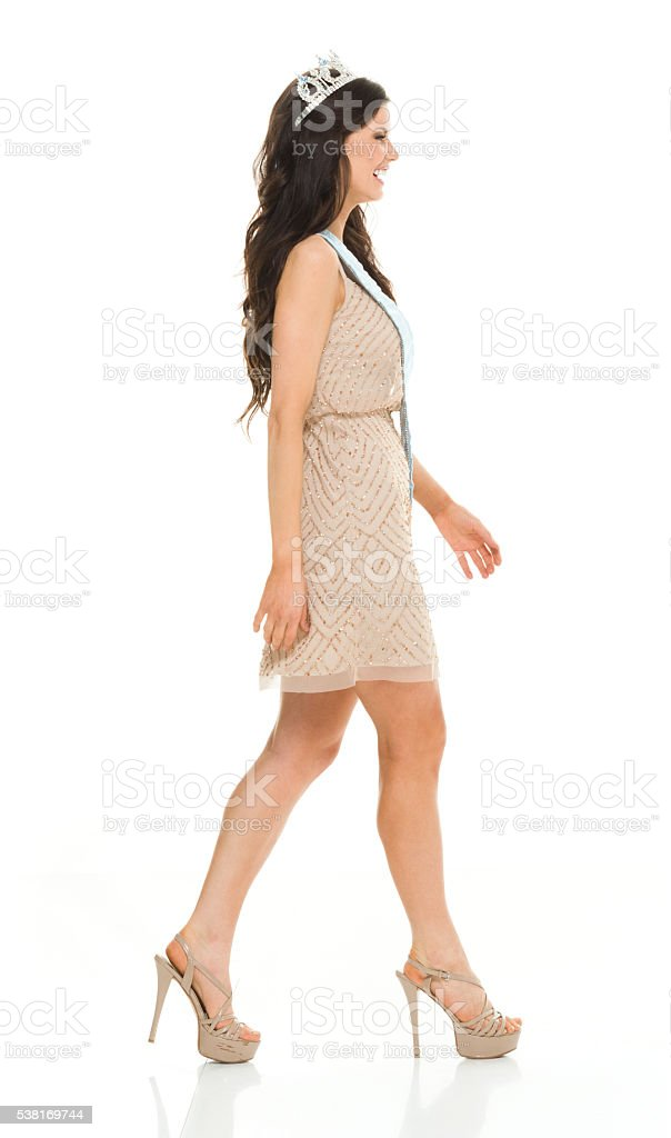 Smiling beauty queen walking stock photo