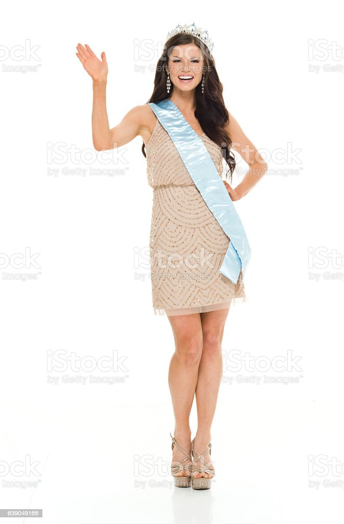 Smiling beauty queen waving hand stock photo