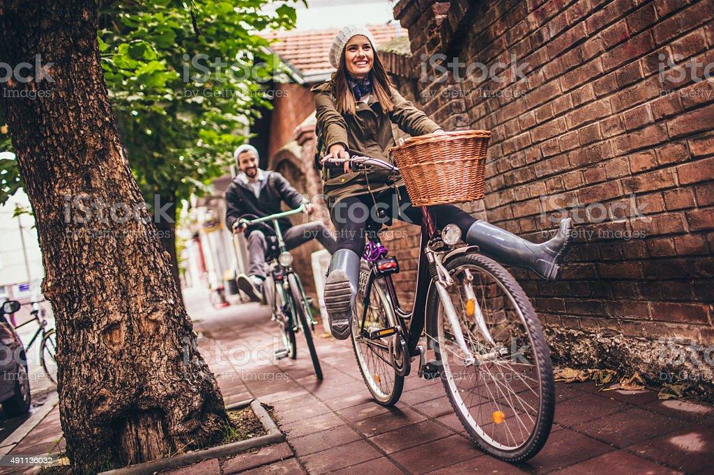 Smiling bike riders stock photo