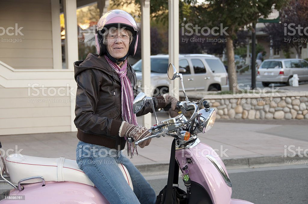 smiling biker in town for some shopping stock photo