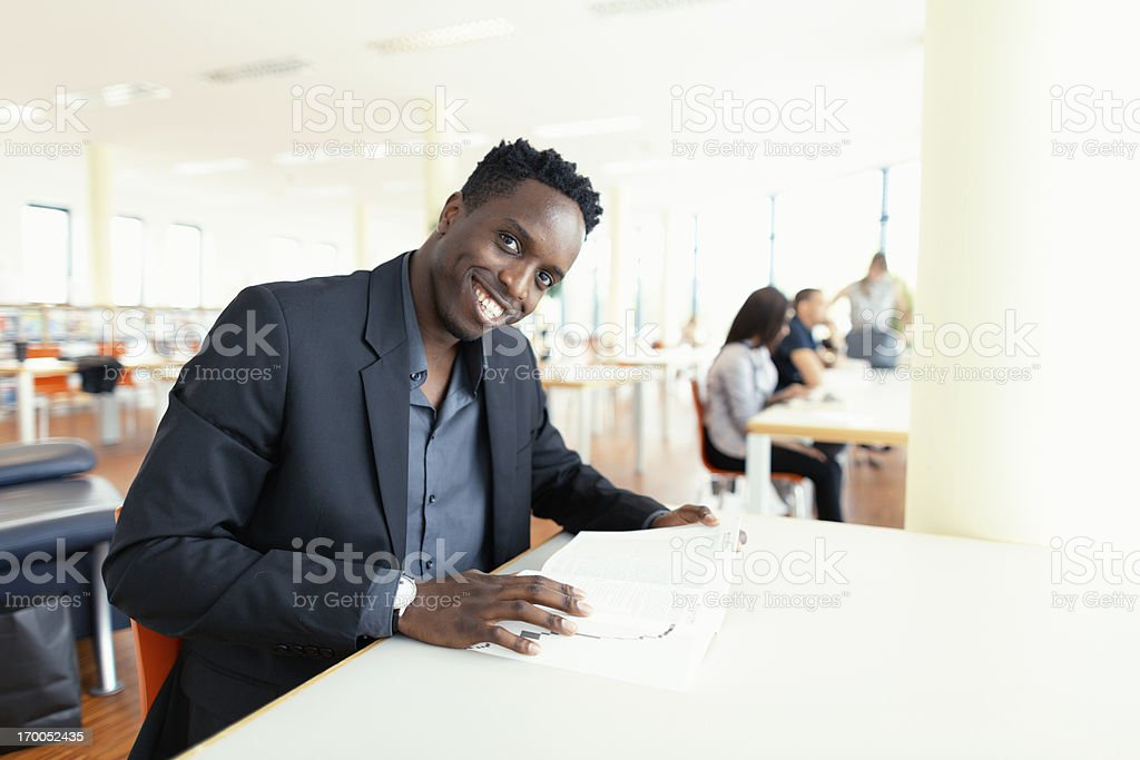 smiling black student in library royalty-free stock photo