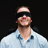 Smiling blindness man giving a pose