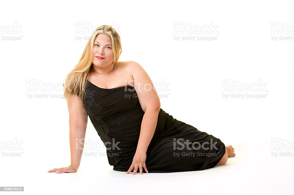 Smiling blond overweight woman in black dress. stock photo
