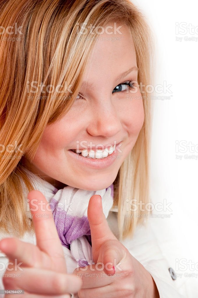Smiling Blond Teen Girl Pointing stock photo