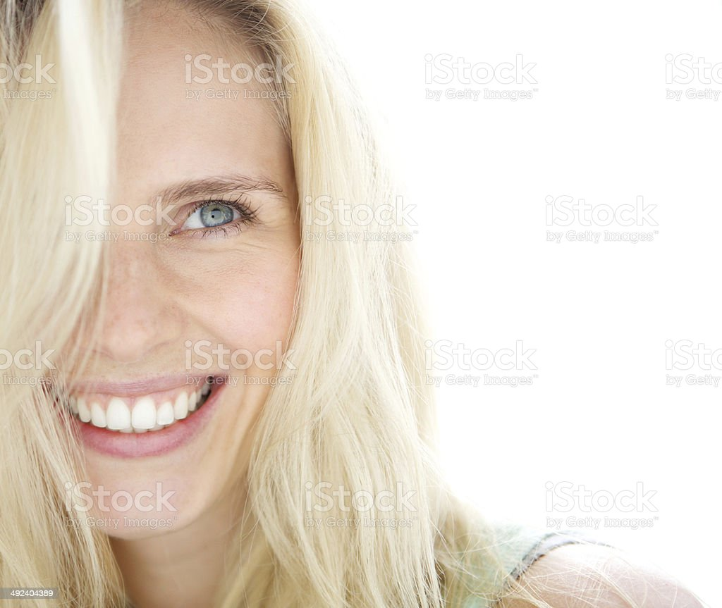 Smiling blond woman stock photo