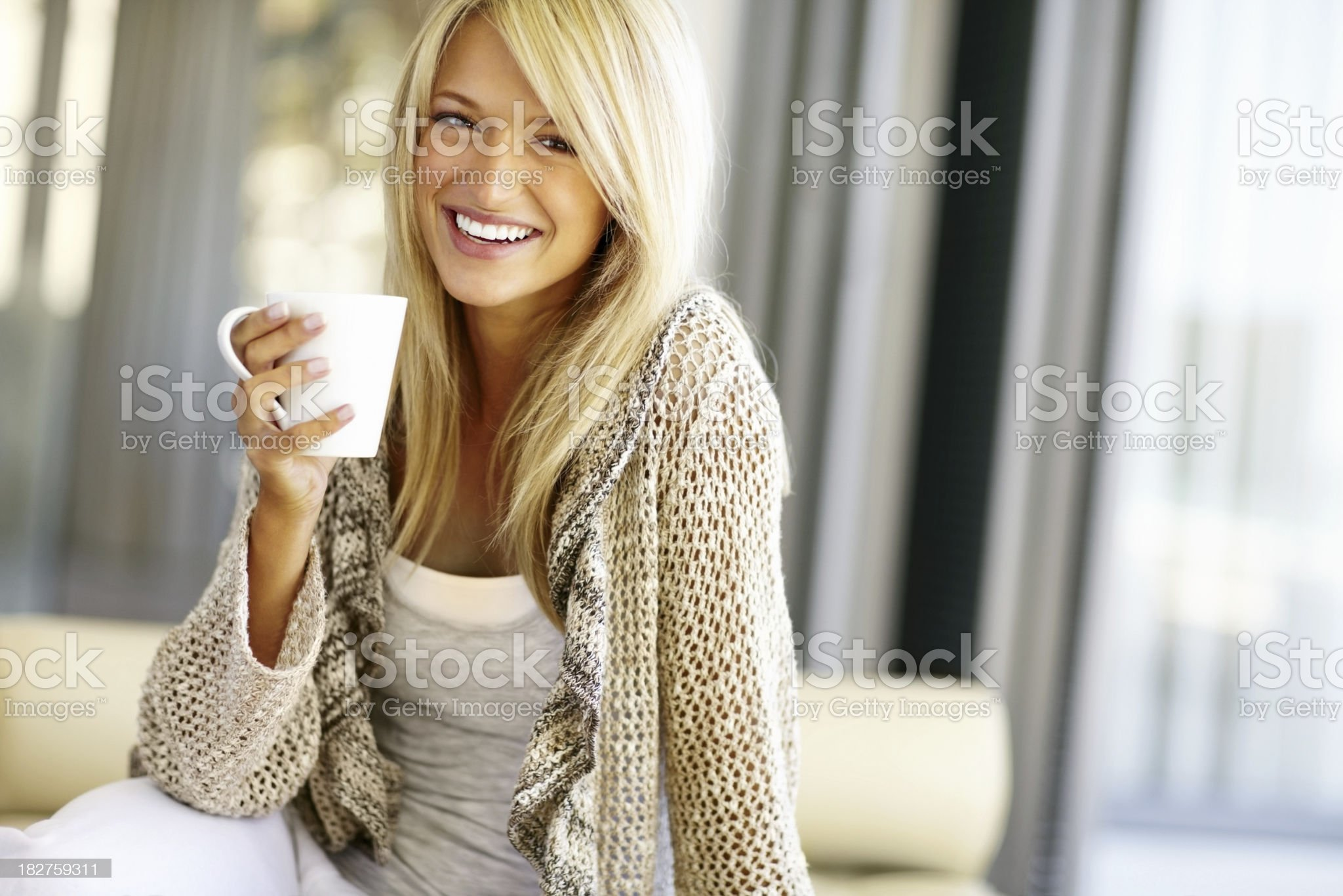 Smiling blond woman with a cup of coffee royalty-free stock photo
