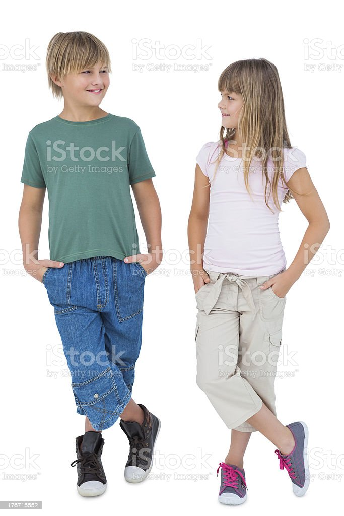 Smiling blonde children looking at each other royalty-free stock photo