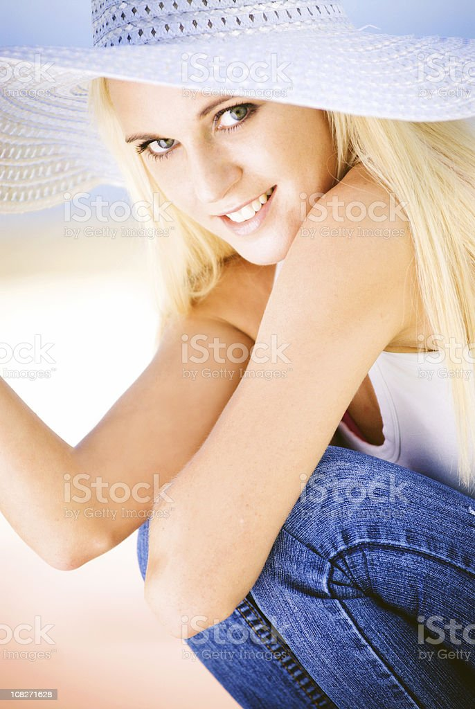 Smiling blonde girl with hat royalty-free stock photo