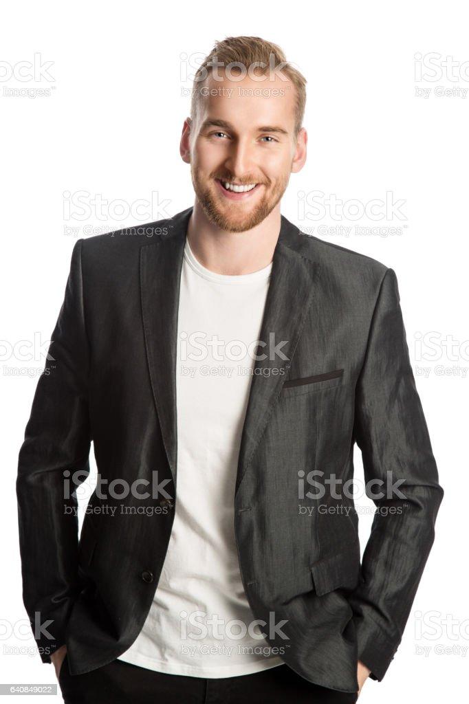 Smiling blonde man in blazer stock photo