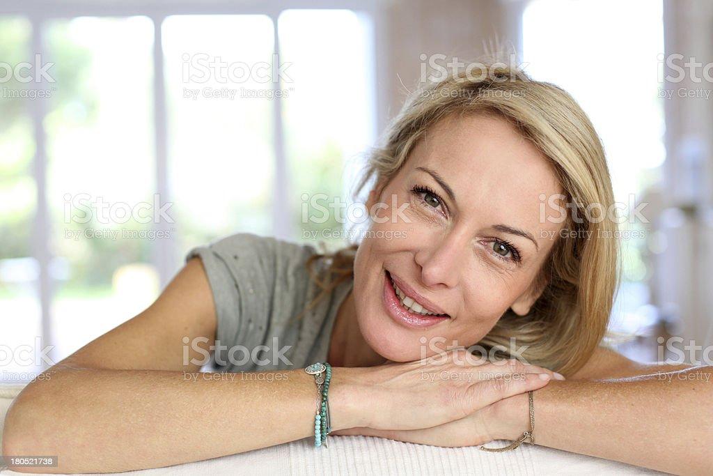 Smiling blonde mature woman looking at camera royalty-free stock photo