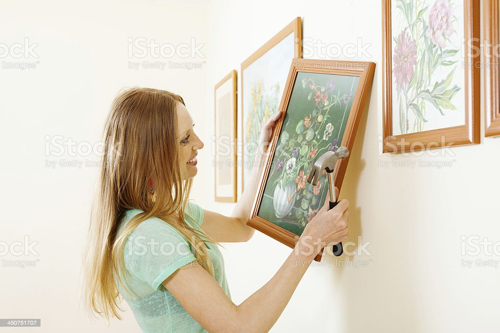 Smiling blonde woman hanging  picture stock photo