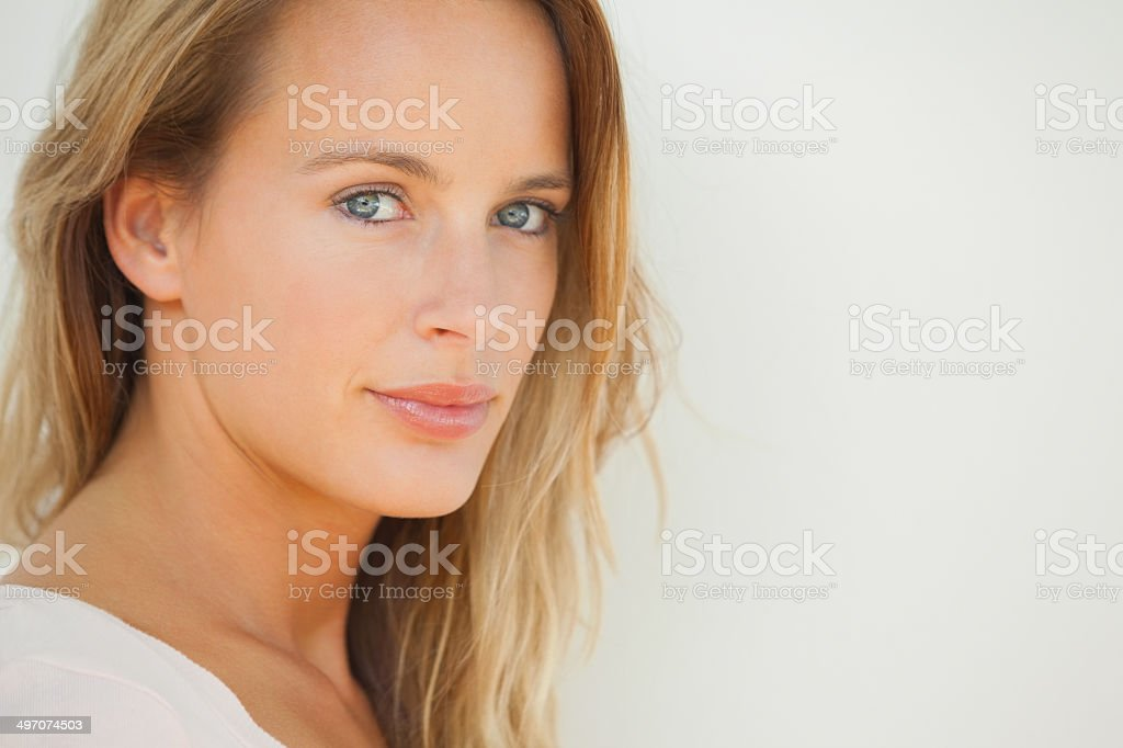 Smiling blonde woman posing looking at camera royalty-free stock photo