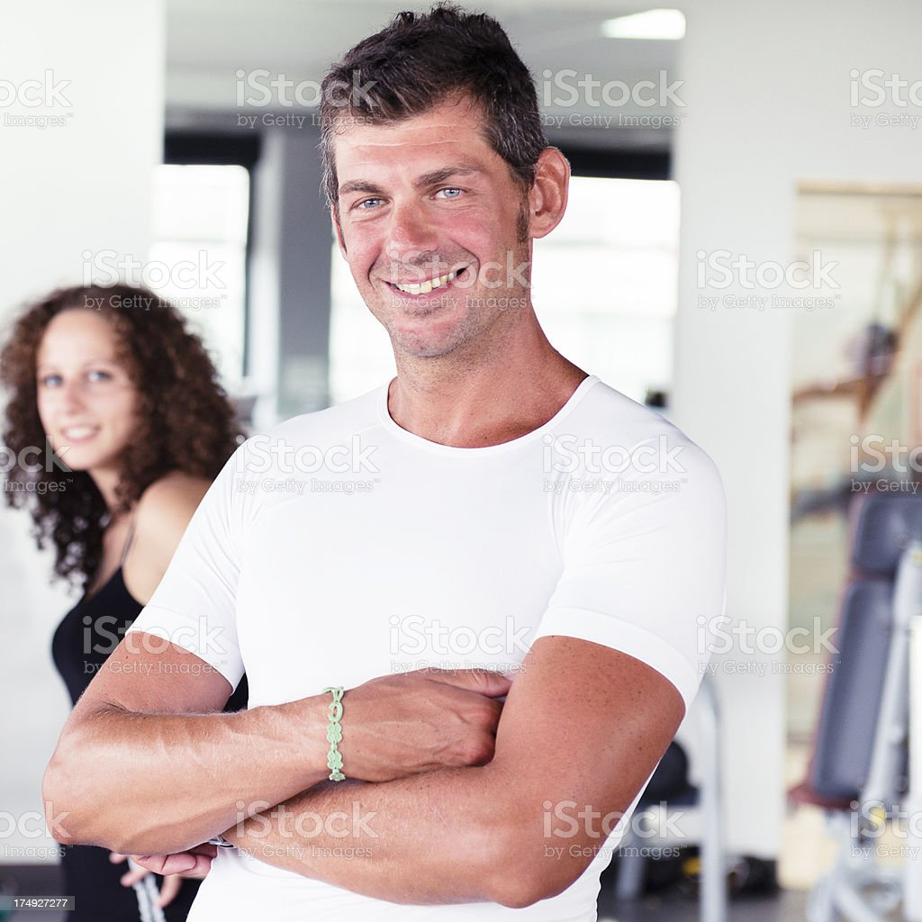 Smiling boss inside a gym royalty-free stock photo