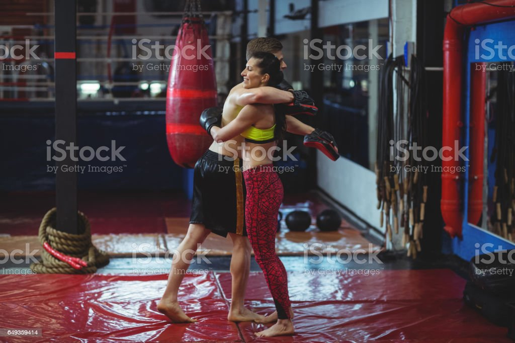 Smiling boxers embracing each other stock photo