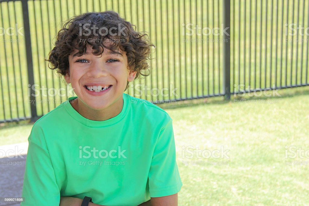 Smiling Boy at the Park stock photo