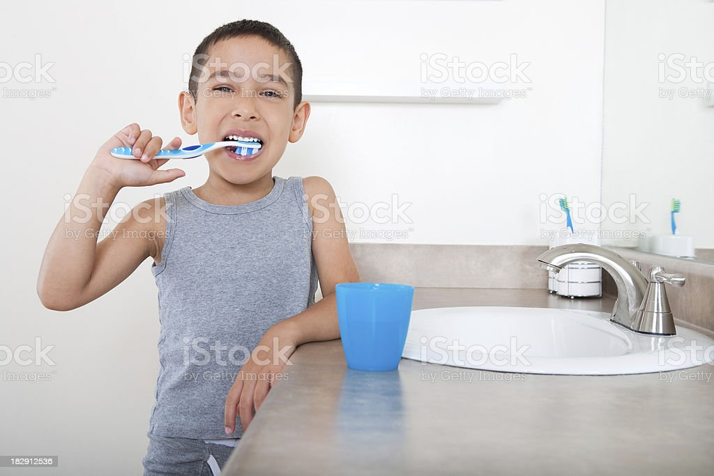 Smiling boy brushing teeth royalty-free stock photo