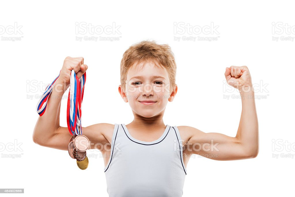 Smiling boy champion with victory metals and showing muscles stock photo