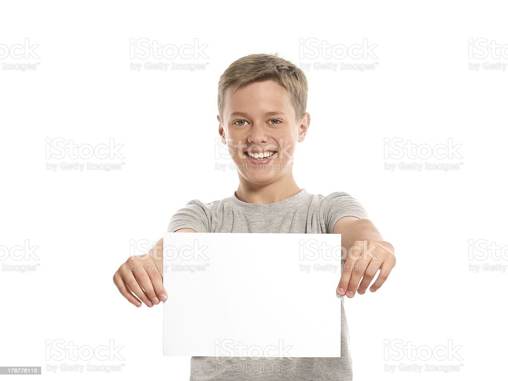 Smiling boy hold white blank paper royalty-free stock photo