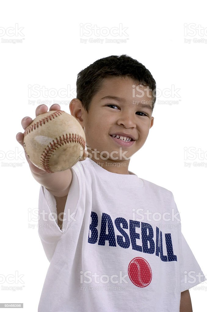 Smiling boy holding a baseball stock photo