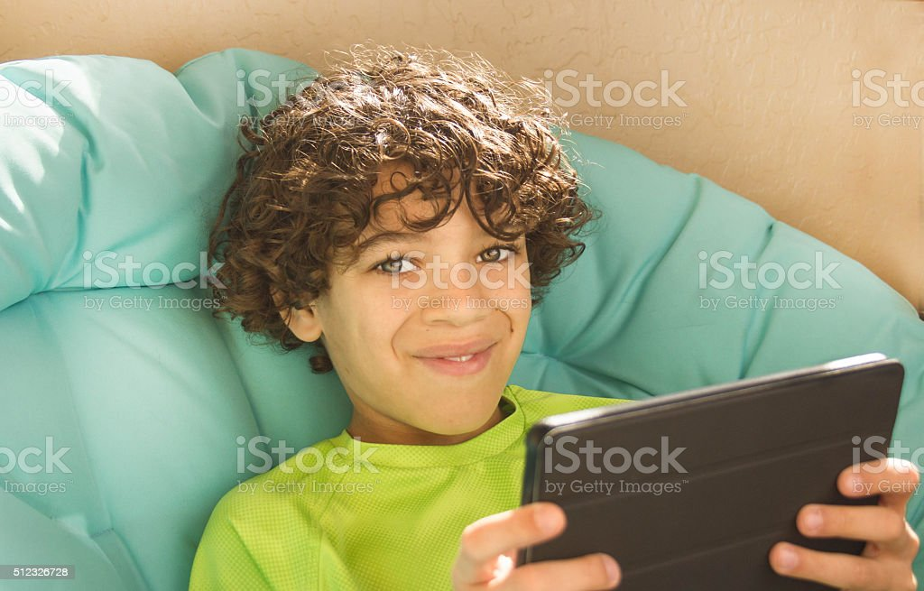 Smiling Boy Holding Tablet stock photo