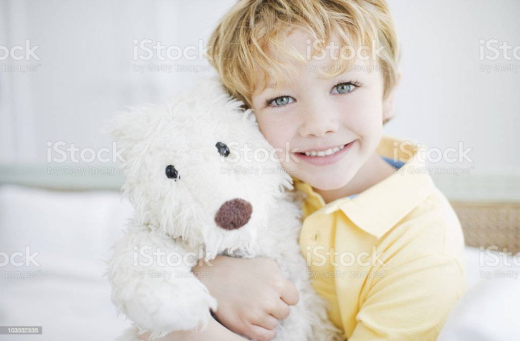Smiling boy hugging teddy bear royalty-free stock photo
