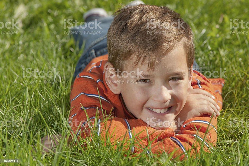 Smiling boy in orange shirt royalty-free stock photo