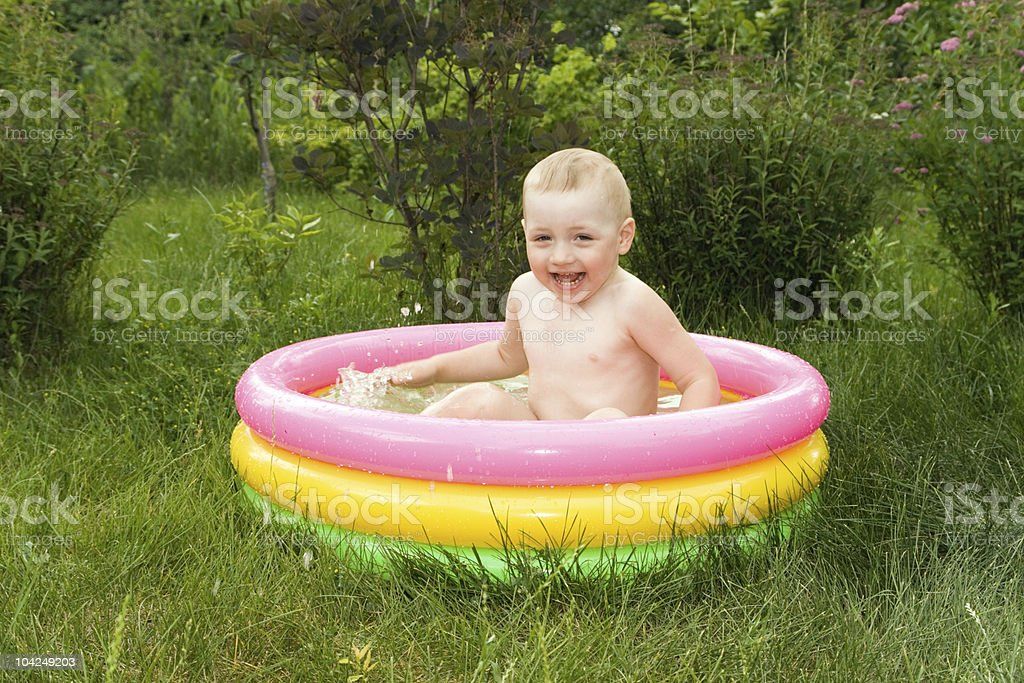 Smiling boy in the swimming-pool royalty-free stock photo