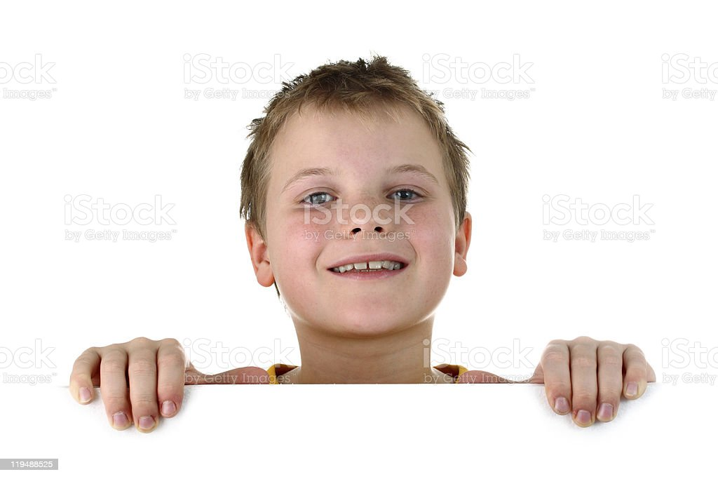 Smiling boy looking out of blank whiteboard isolated on white royalty-free stock photo