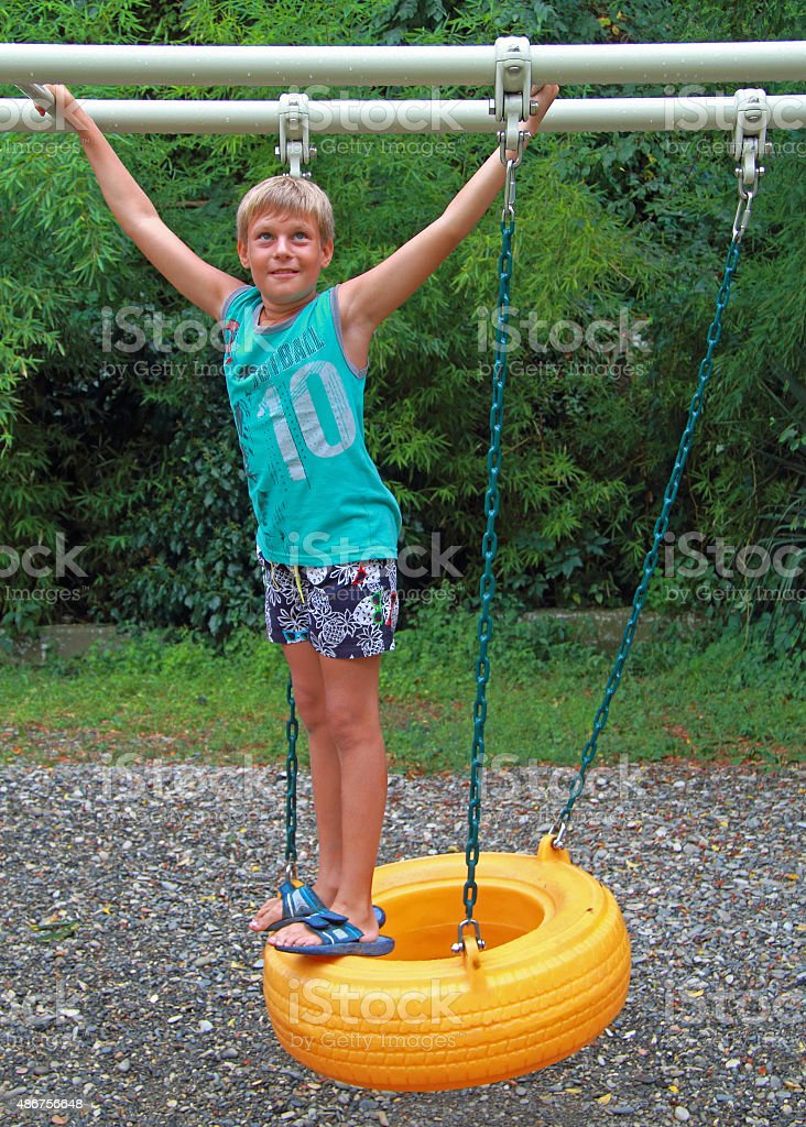 smiling boy on obstacle course stock photo