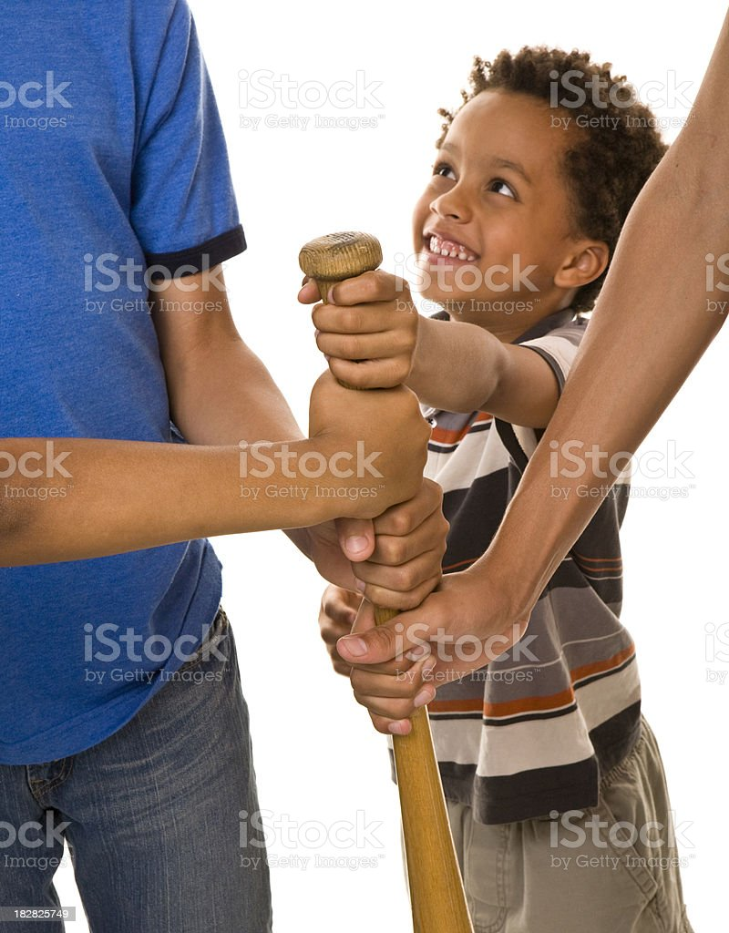 Smiling boy playing hand over hand on bat royalty-free stock photo