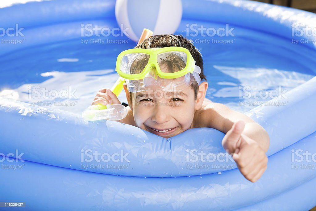 Smiling boy swimming outdoor stock photo