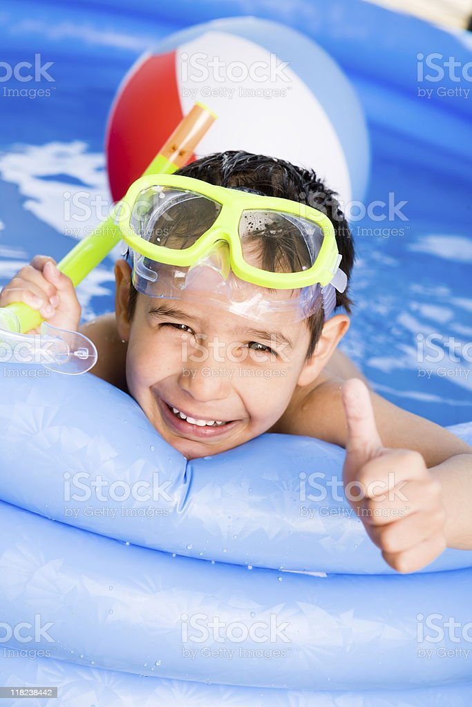 Smiling boy swimming outdoor royalty-free stock photo