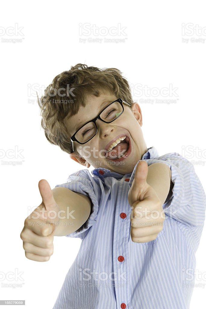 smiling boy wearing eyeglasses showing thumbs up royalty-free stock photo