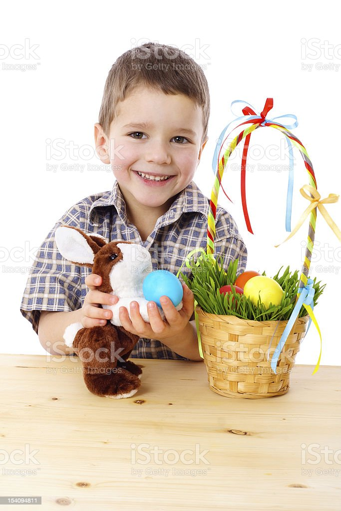 Smiling boy with easter eggs and bunny royalty-free stock photo