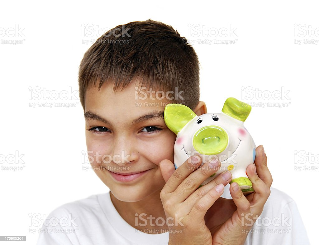 Smiling boy with piggy box royalty-free stock photo
