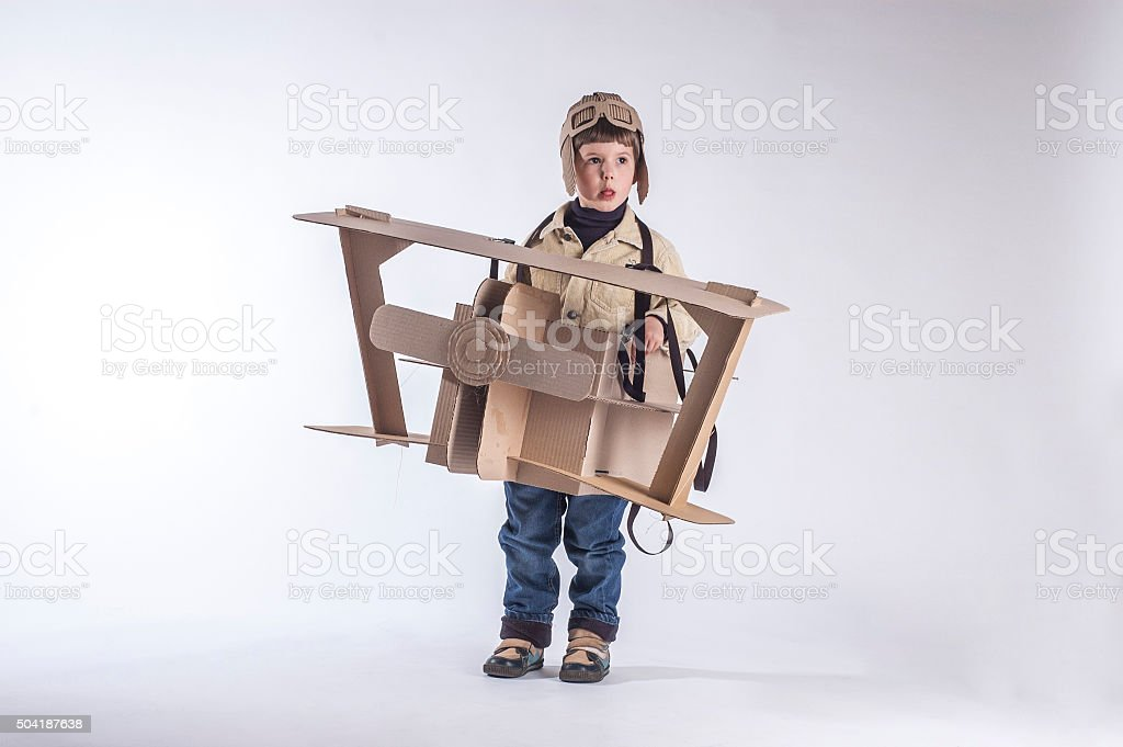 smiling boy with plane stock photo