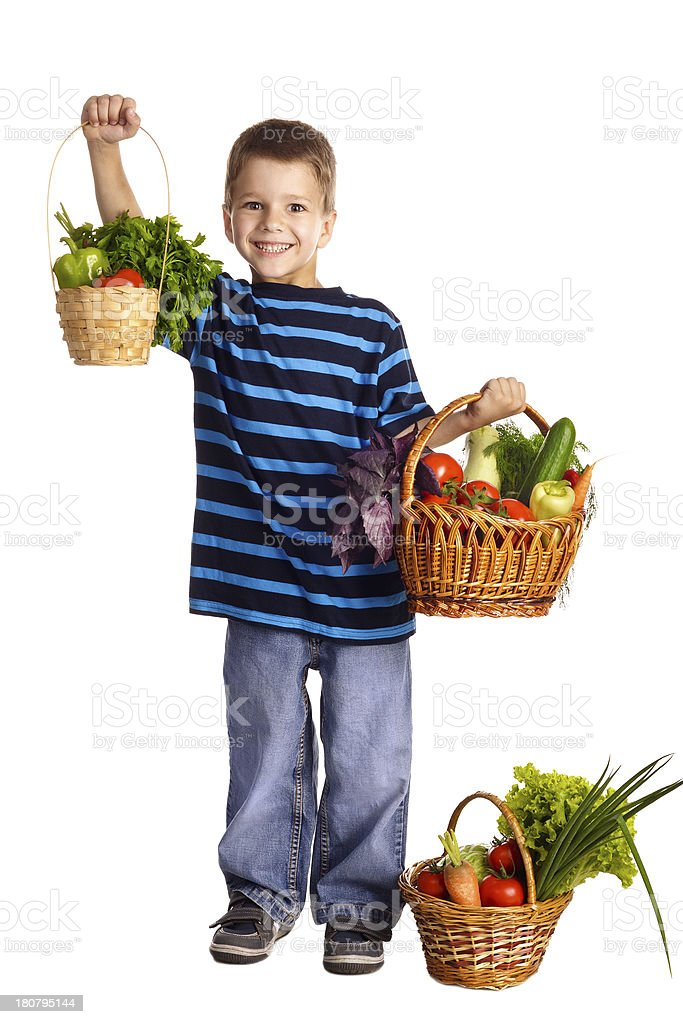 Smiling boy with vegetables in basket royalty-free stock photo