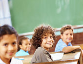 Smiling boys and girls in the classroom