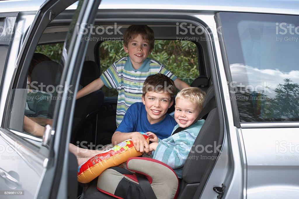 Smiling Boys In Car stock photo