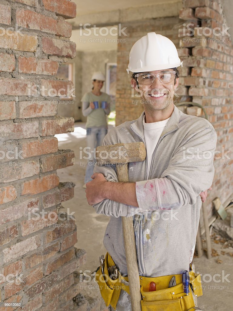 Smiling bricklayer at construction site stock photo