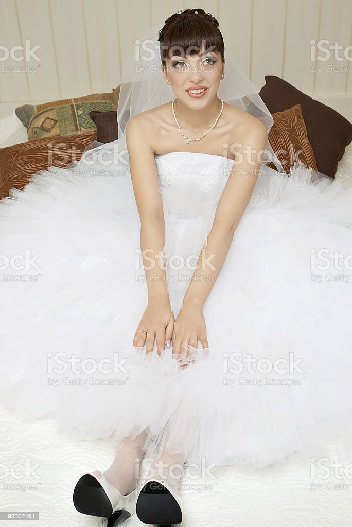 smiling bride looking up royalty-free stock photo