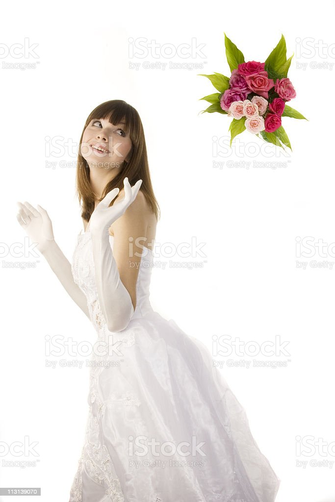 Smiling bride tossing a bouquet. royalty-free stock photo
