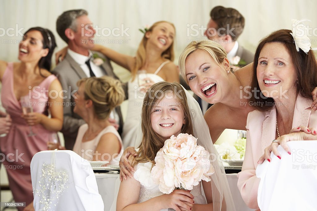 Smiling bride with relatives and guests at wedding stock photo