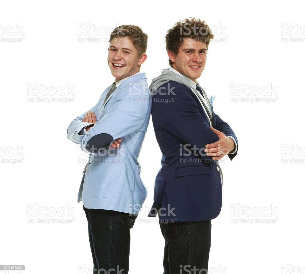 Smiling brothers standing together stock photo